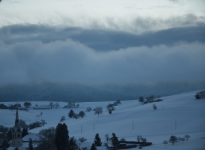 The fog rolls in over the village of Schleitheim, SH in Switzerland.