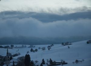 The fog rolls in over the village of Schleitheim, SH in Switzerland.