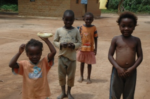 Village children in Zambia with a full cob of Maize