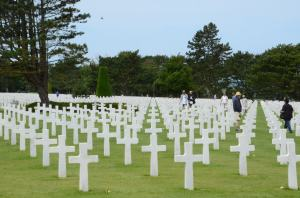 White crosses of the victors at Omaha beach; across the road are the dark ones.